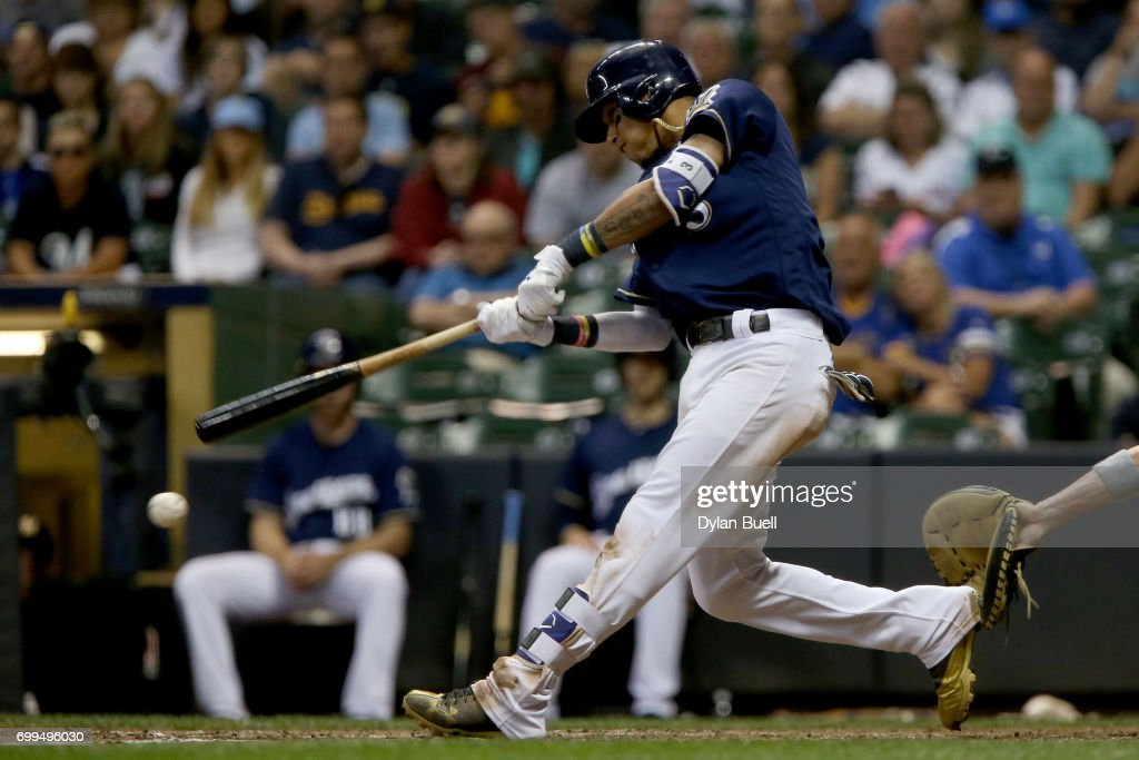 Orlando Arcia #3 of the Milwaukee Brewers hits a double in the seventh inning against the Pittsburgh Pirates at Miller Park on June 21, 2017 in Milwaukee, Wisconsin.