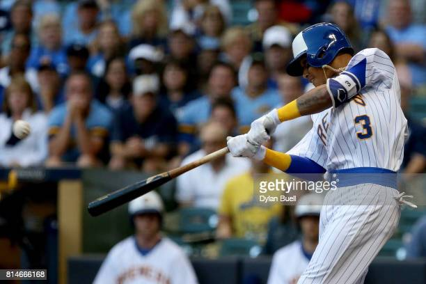 Orlando Arcia of the Milwaukee Brewers hits a home run in the second inning against the Philadelphia Phillies at Miller Park on July 14 2017 in...