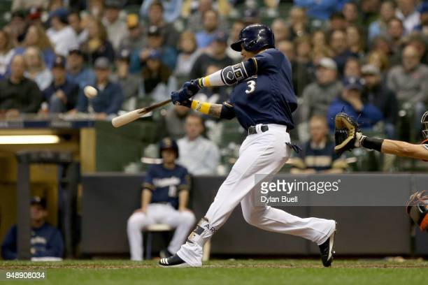 Orlando Arcia of the Milwaukee Brewers hits a home run in the sixth inning against the Miami Marlins at Miller Park on April 19 2018 in Milwaukee...