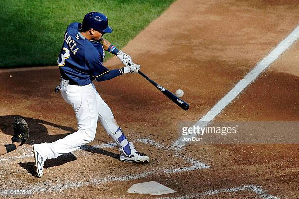 Orlando Arcia of the Milwaukee Brewers hits a single against the Cincinnati Reds during the seventh inning at Miller Park on September 25 2016 in...