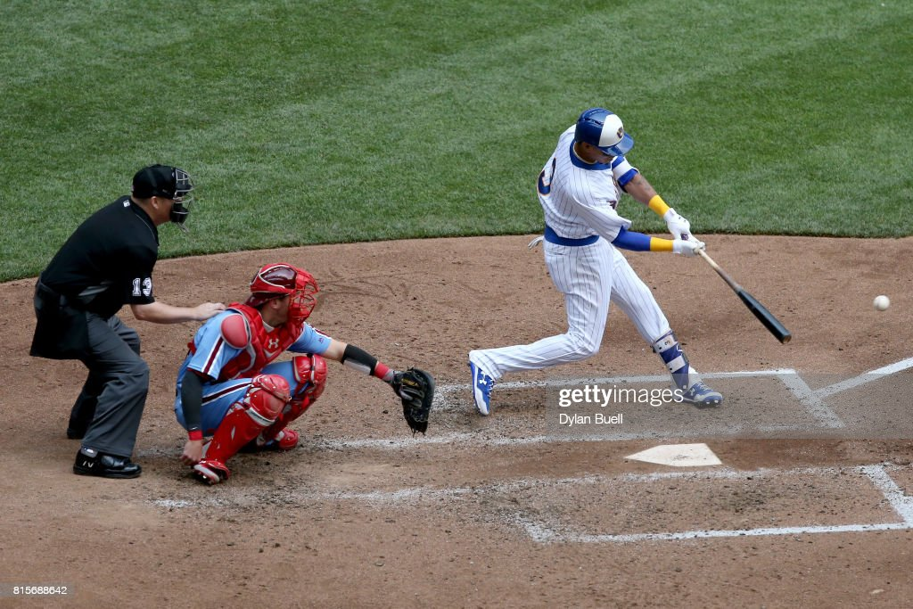 Orlando Arcia #3 of the Milwaukee Brewers hits a single in the fifth inning against the Philadelphia Phillies at Miller Park on July 16, 2017 in Milwaukee, Wisconsin.