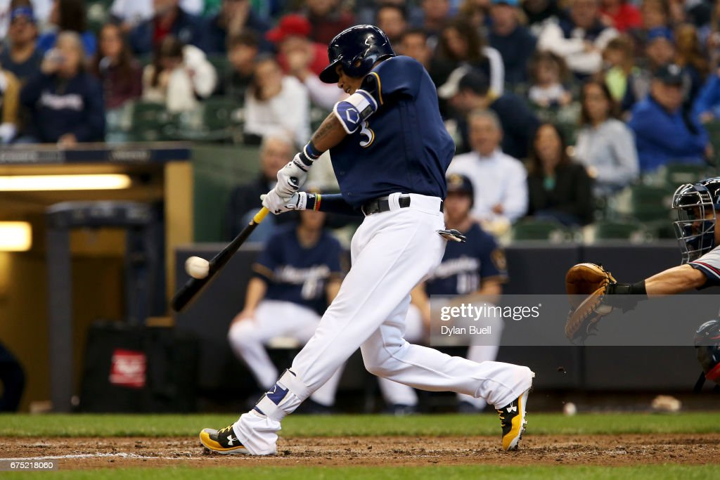 Orlando Arcia #3 of the Milwaukee Brewers hits a single in the seventh inning against the Atlanta Braves at Miller Park on April 30, 2017 in Milwaukee, Wisconsin.