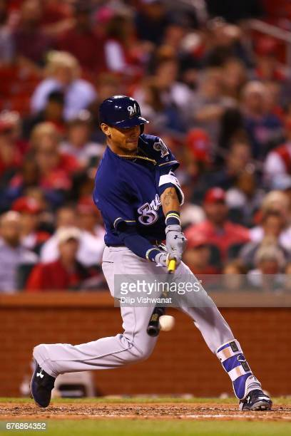Orlando Arcia of the Milwaukee Brewers hits into a groundout against the St Louis Cardinals in the fifth inning at Busch Stadium on May 2 2017 in St...
