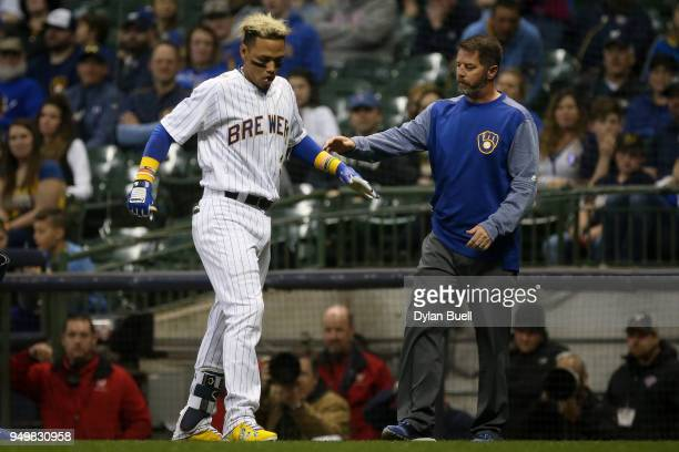 Orlando Arcia of the Milwaukee Brewers is attended to after being injured in the eighth inning against the Miami Marlins at Miller Park on April 20...
