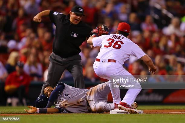 Orlando Arcia of the Milwaukee Brewers is called out at third base against Aledmys Diaz of the St Louis Cardinals at Busch Stadium on September 29...