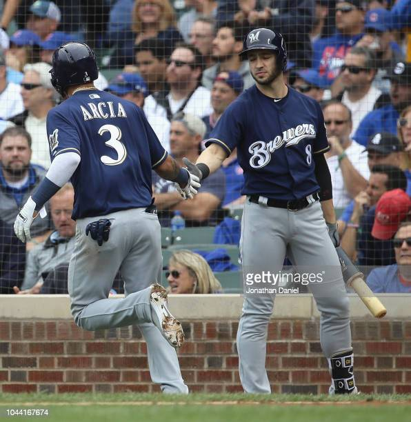 Orlando Arcia of the Milwaukee Brewers is congratulated by Ryan Braun after scoring a run in the 3rd inning against the Chicago Cubs during the...