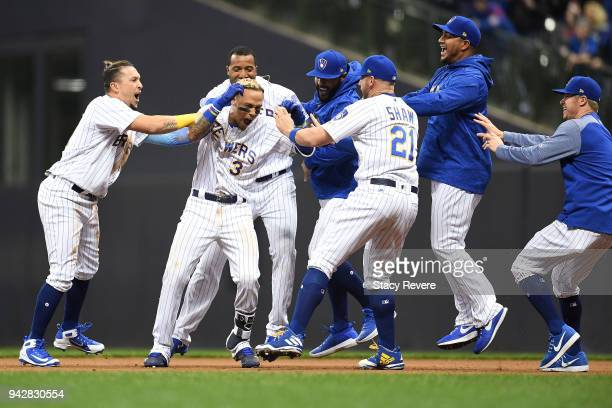 Orlando Arcia of the Milwaukee Brewers is congratulated by teammates after the game winning hit in the ninth inning against the Chicago Cubs at...