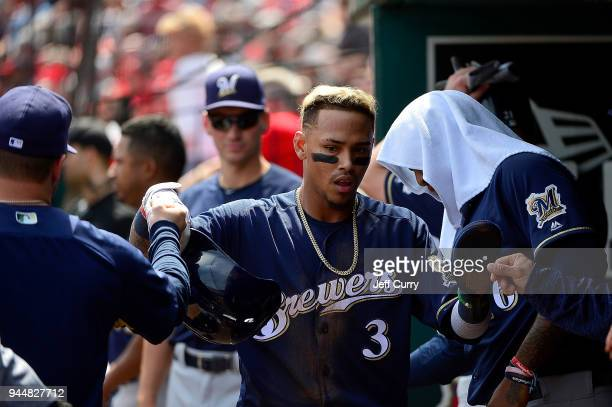 Orlando Arcia of the Milwaukee Brewers is congratulated by teammates after scoring a run during the fifth inning against the St Louis Cardinals at...