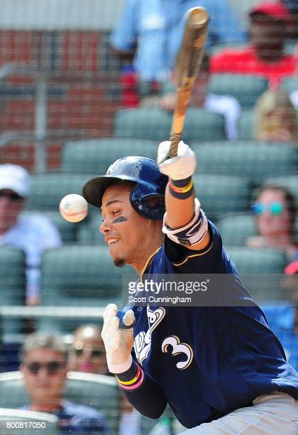Orlando Arcia of the Milwaukee Brewers is hit in the face by a foul tip during the eighth inning against the Atlanta Braves at SunTrust Park on June...