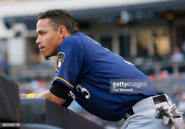 Orlando Arcia of the Milwaukee Brewers looks out from the dugout during an MLB baseball game against the New York Mets on May 31 2017 at CitiField in...