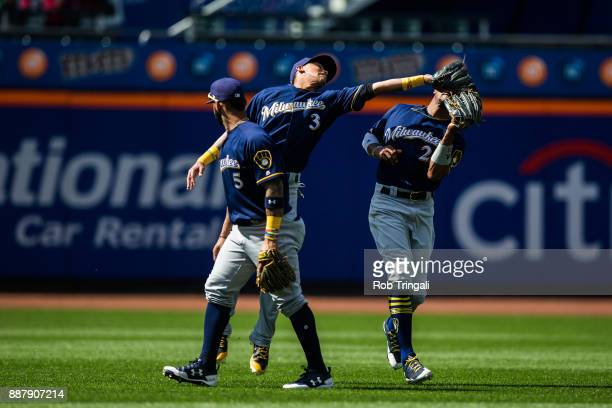 Orlando Arcia of the Milwaukee Brewers makes a catch over Keon Broxton during the game against the New York Mets at Citi Field on Thursday June 1...
