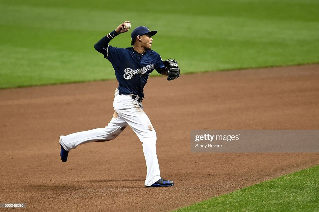 Orlando Arcia #3 of the Milwaukee Brewers makes a throw to first base during the fifth inning of a game against the Colorado Rockies at Miller Park on April 5, 2017 in Milwaukee, Wisconsin.