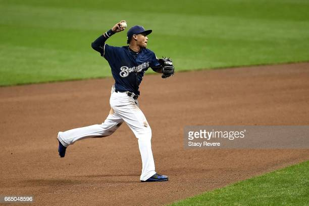 Orlando Arcia of the Milwaukee Brewers makes a throw to first base during the fifth inning of a game against the Colorado Rockies at Miller Park on...