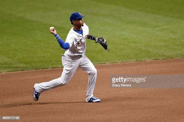 Orlando Arcia of the Milwaukee Brewers makes a throw to first base during the fourth inning of a game against the Chicago Cubs at Miller Park on...