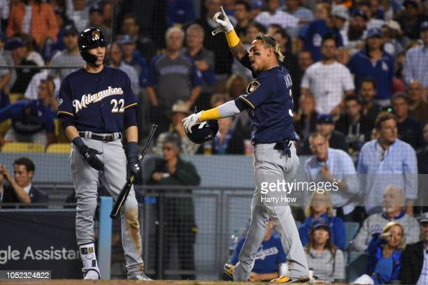 Orlando Arcia of the Milwaukee Brewers reacts after scoring a run during the fifth inning on a RBI double by Domingo Santana against the Los Angeles...