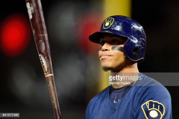 Orlando Arcia of the Milwaukee Brewers reacts to striking out against the Minnesota Twins during the game on August 8 2017 at Target Field in...