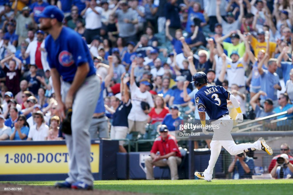 Orlando Arcia #3 of the Milwaukee Brewers rounds the bases after hitting a home run as Wade Davis #71 of the Chicago Cubs looks on in the ninth inning at Miller Park on September 23, 2017 in Milwaukee, Wisconsin.