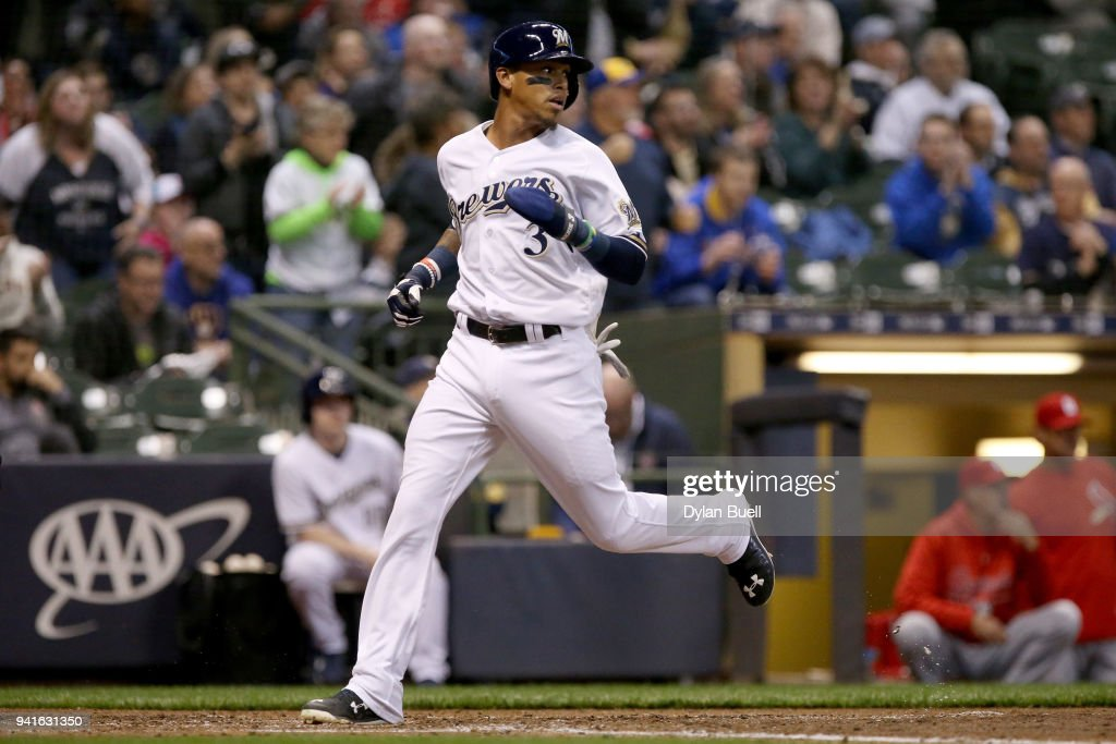 Orlando Arcia #3 of the Milwaukee Brewers scores a run in the fifth inning against the St. Louis Cardinals at Miller Park on April 3, 2018 in Milwaukee, Wisconsin.