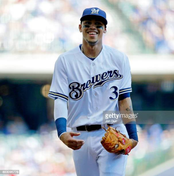 Orlando Arcia of the Milwaukee Brewers smiles after making a double play against the Chicago Cubs to end the first inning at Miller Park on September...