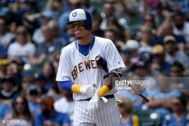 Orlando Arcia of the Milwaukee Brewers smiles while batting in the third inning against the Philadelphia Phillies at Miller Park on July 16 2017 in...