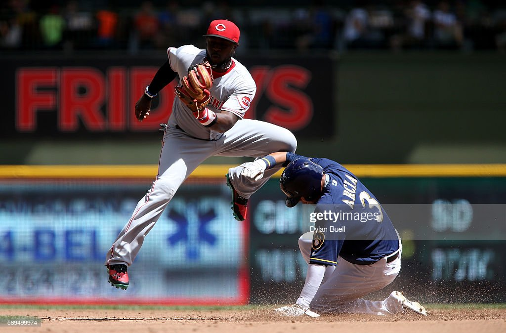 Orlando Arcia #3 of the Milwaukee Brewers steals second base past Brandon Phillips #4 of the Cincinnati Reds in the first inning at Miller Park on August 14, 2016 in Milwaukee, Wisconsin.