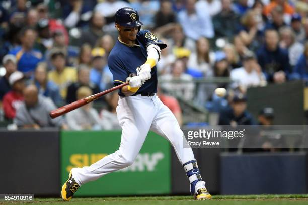 Orlando Arcia of the Milwaukee Brewers swings at a pitch during the fourth inning of a game against the Cincinnati Reds at Miller Park on September...