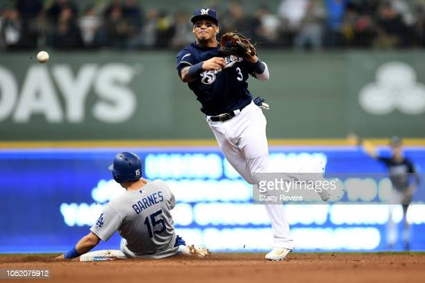 Orlando Arcia of the Milwaukee Brewers tags out Austin Barnes of the Los Angeles Dodgers and turns out a double play to first base to close out...