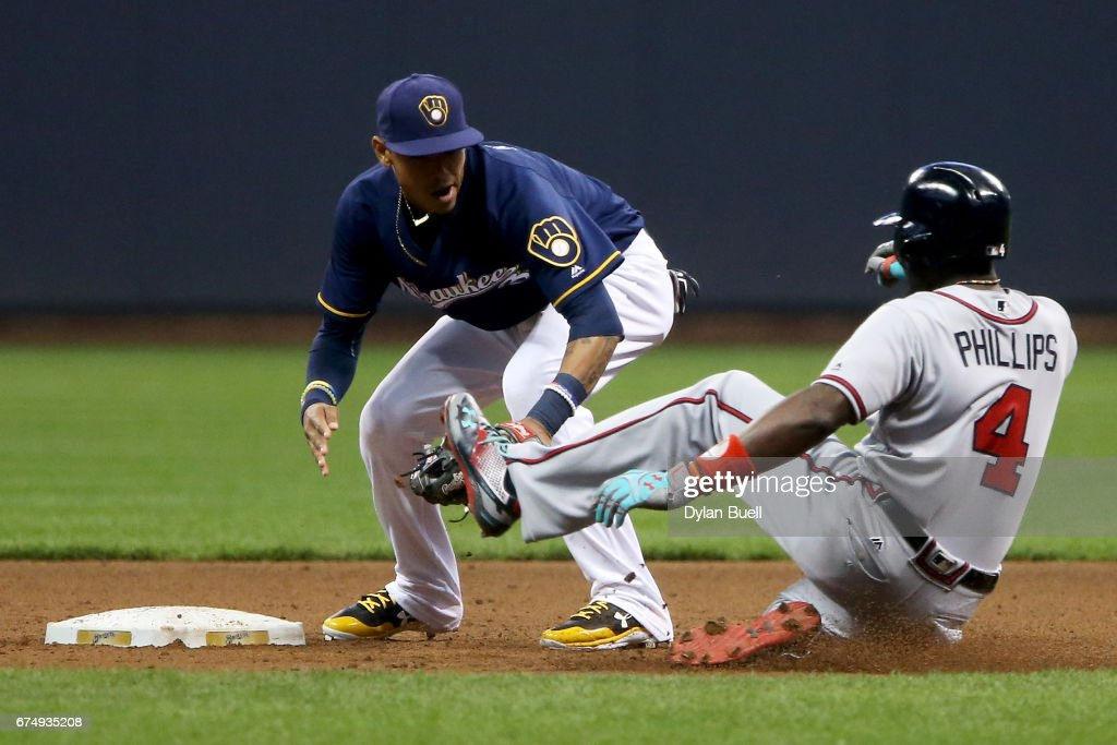 Orlando Arcia #3 of the Milwaukee Brewers tags out Brandon Phillips #4 of the Atlanta Braves at second base in the second inning at Miller Park on April 29, 2017 in Milwaukee, Wisconsin.