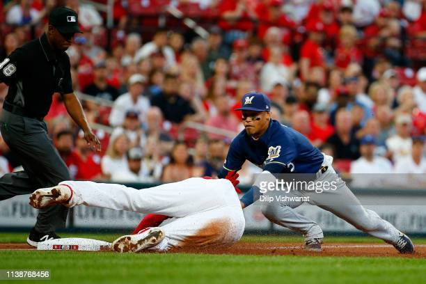 Orlando Arcia of the Milwaukee Brewers tags out Jose Martinez of the St Louis Cardinals at third base in the second inning at Busch Stadium on April...
