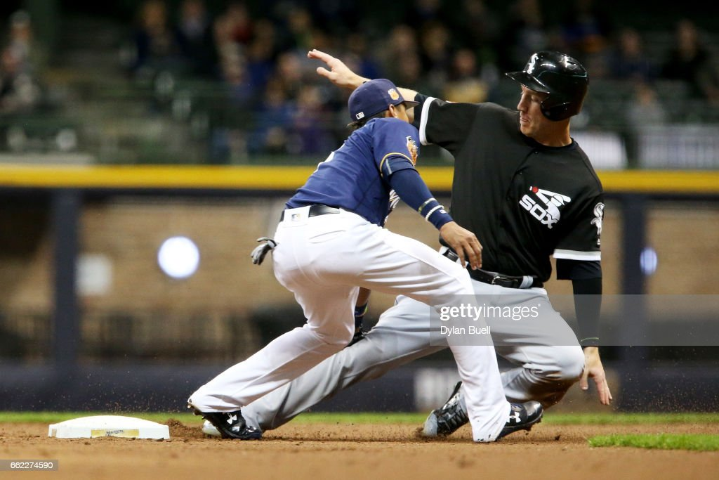 Orlando Arcia #3 of the Milwaukee Brewers tags out Todd Frazier #21 of the Chicago White Sox during a steal attempt in the second inning during an exhibition game at Miller Park on March 31, 2017 in Milwaukee, Wisconsin.