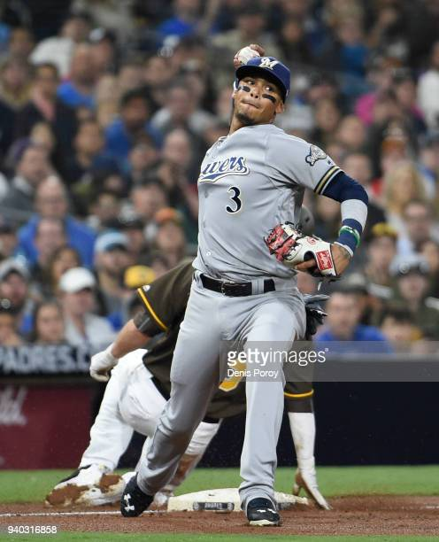Orlando Arcia of the Milwaukee Brewers throws after getting the force out at third base on Cory Spangenberg of the San Diego Padres during the fourth...