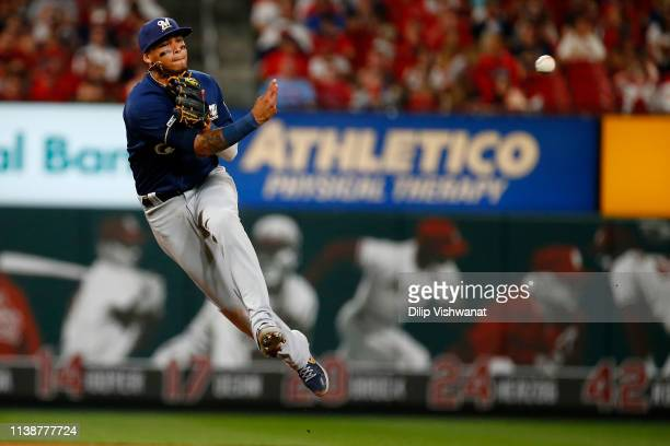Orlando Arcia of the Milwaukee Brewers throws to first base against the St Louis Cardinals in the fifth inning at Busch Stadium on April 22 2019 in...