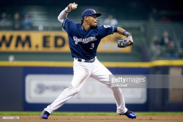 Orlando Arcia of the Milwaukee Brewers throws to first base in the fifth inning against the Colorado Rockies at Miller Park on April 4 2017 in...