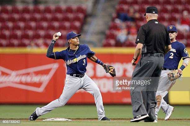 Orlando Arcia of the Milwaukee Brewers turns a double play in the second inning against the Cincinnati Reds at Great American Ball Park on September...