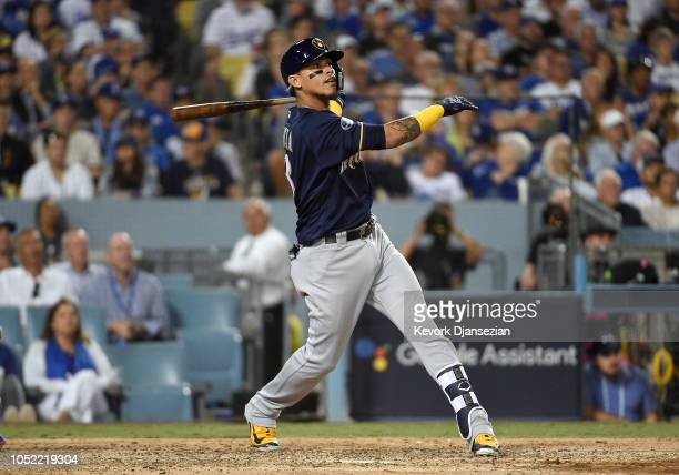 Orlando Arcia of the Milwaukee Brewers watches his hit go for a tworun home run over the right field wall during the seventh inning of Game Three of...