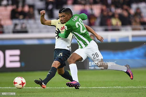 Orlando Berrio of Atletico Nacional competes for the ball against Miguel Samudio of Club America during the FIFA Club World Cup 3rd place match...