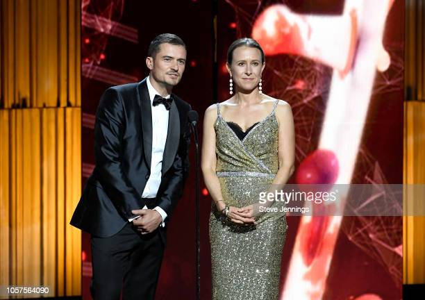 Orlando Bloom and Anne Wojcicki attend the 2019 Breakthrough Prize at NASA Ames Research Center on November 4 2018 in Mountain View California