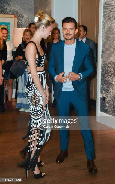 Orlando Bloom and Cara Delevingne attend the Amazon Original series Carnival Row London Screening at The Ham Yard Hotel on August 28 2019 in London...