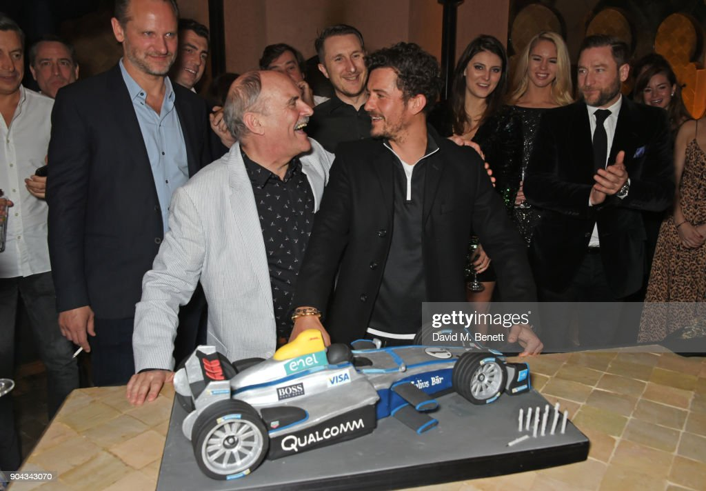 Orlando Bloom and father Colin Stone pose with his birthday cake as friend Charlie Muirhead, Scott Campbell and Andres Faucher look on at Orlando Bloom's birthday party with ABB FIA Formula E Championship at Hotel Amanjena on January 12, 2018 in Marrakech, Morocco.