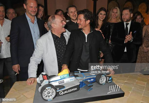 Orlando Bloom and father Colin Stone pose with his birthday cake as friend Charlie Muirhead Scott Campbell and Andres Faucher look on at Orlando...