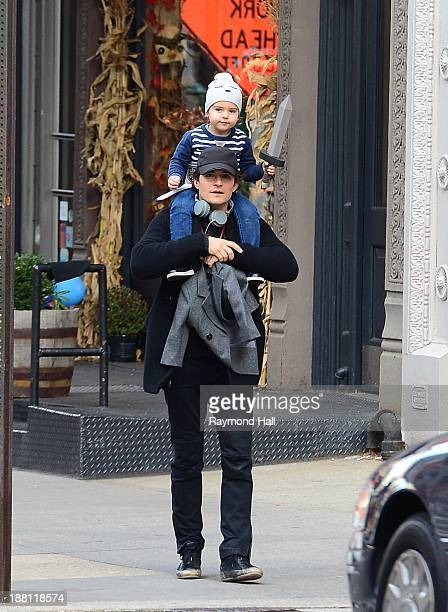 Orlando Bloom and Flynn Bloom are seen Walking in Soho on November 15 2013 in New York City