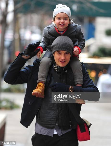 Orlando Bloom and Flynn Christopher Bloom are seen in Midtown on December 19 2013 in New York City