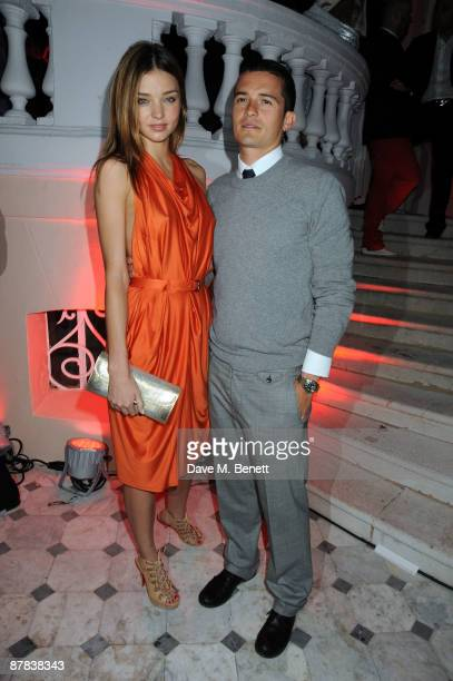 Orlando Bloom and his girlfriend Miranda Kerr pose for a picture as attend the Akvinta Presents Hollywood Dominos held at the The House At Cannes...