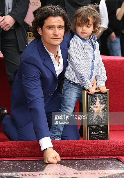 Orlando Bloom and his son Flynn Bloom are honored with a star on the Walk of Fame on April 2 2014 in Hollywood California