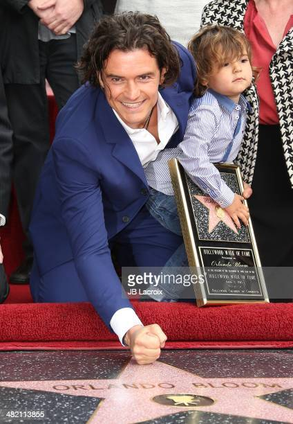 Orlando Bloom and his son Flynn Bloom attend the Hollywood Walk of Fame celebration in honor of Orlando Bloom on April 2 2014 in Hollywood California