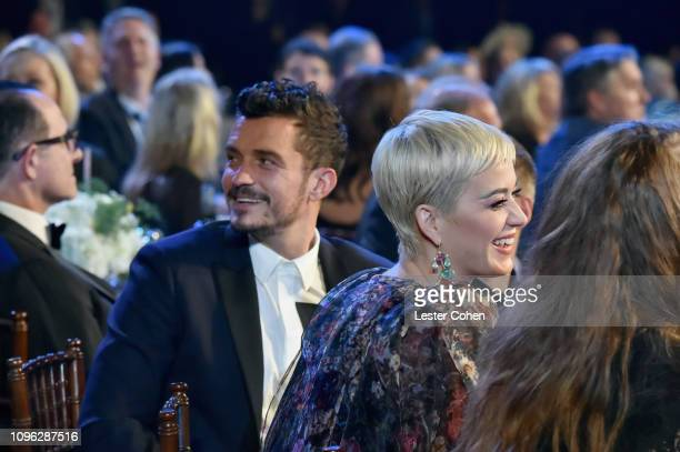 Orlando Bloom and Katy Perry attend MusiCares Person of the Year honoring Dolly Parton at Los Angeles Convention Center on February 8 2019 in Los...