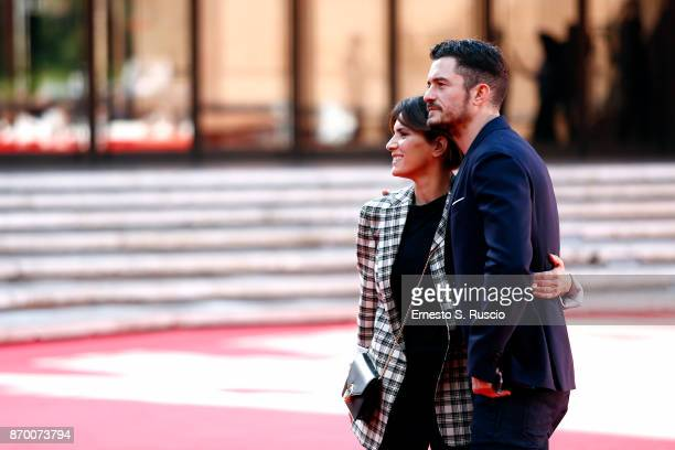 Orlando Bloom and Maya Sansa walk a red carpet for 'Romans' during the 12th Rome Film Fest at Auditorium Parco Della Musica on November 4 2017 in...