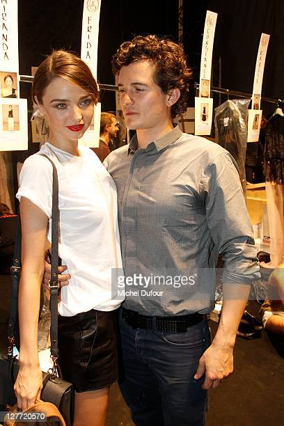 Orlando Bloom and Miranda Kerr attend the Christian Dior Ready to Wear Spring / Summer 2012 show during Paris Fashion Week at Musee Rodin on...