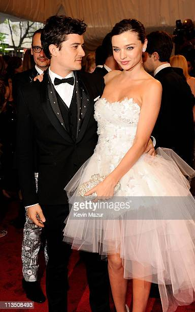 Orlando Bloom and Miranda Kerr attends the Alexander McQueen Savage Beauty Costume Institute Gala at The Metropolitan Museum of Art on May 2 2011 in...