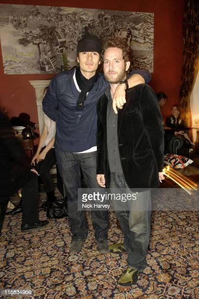 Orlando Bloom and Tom Hollander during Harpers Bazaar Party in London April 21 2006 at Dover Street Arts Club in London Great Britain